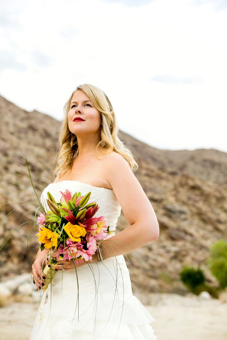 The bride and groom's color palette was inspired by the mid-century desert vibe of Palm Springs.  They went with a vibrant, bright color scheme, but it was mostly pink to orange ombre with pops of navy and yellow.
