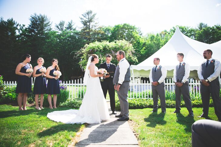 Lovers of the outdoors, Laura and Jacob hosted both their ceremony and reception outdoors. The ceremony took place in the Greenwood Manor Inn's intimate gardens, where an abundance of brightly colored flowers were in full bloom, with Laura and Jacob exchanging vows under a lush, wisteria-draped arbor.