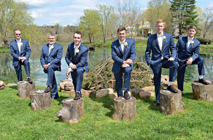"""The groomsmen wore navy tuxedos from Amanda's Touch, a bridal store in Virginia. """"I made all the groomsmen boutonnieres with gold skeleton keys and fabric flowers with cream-colored ribbon tied to the base of the flower,"""" Taylor says."""