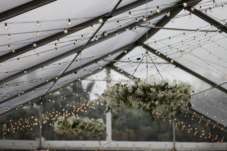 Complementing the couple's natural theme, baby's breath chandeliers were hung from their tented ceiling for both the ceremony and reception.