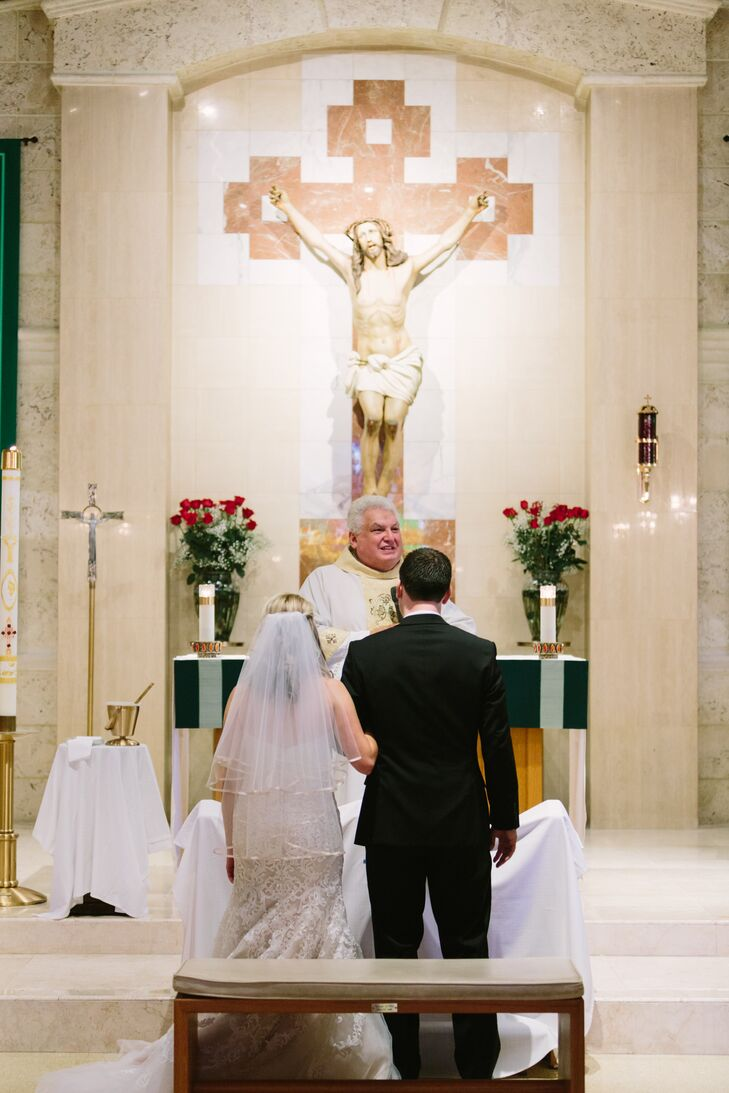 """Even though this was considered a destination wedding for us, we wanted to keep a lot of traditional wedding elements that we both really valued,"" says Laura. The couple was wed at  San Pablo Catholic Church in Marathon, Florida before taking pictures in the church's prayer garden."
