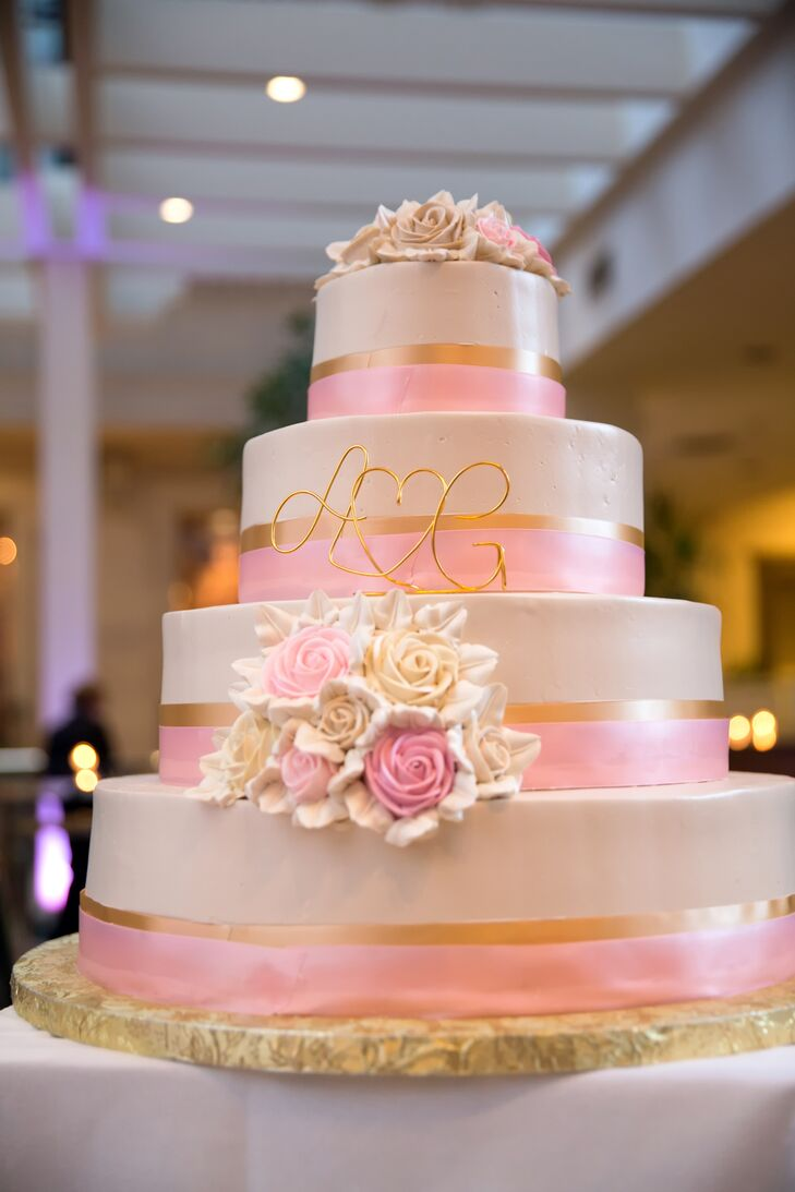 A pink ribbon was wrapped around each layer of the romantic rose decorated cake.