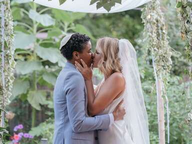 Couple kiss at wedding ceremony
