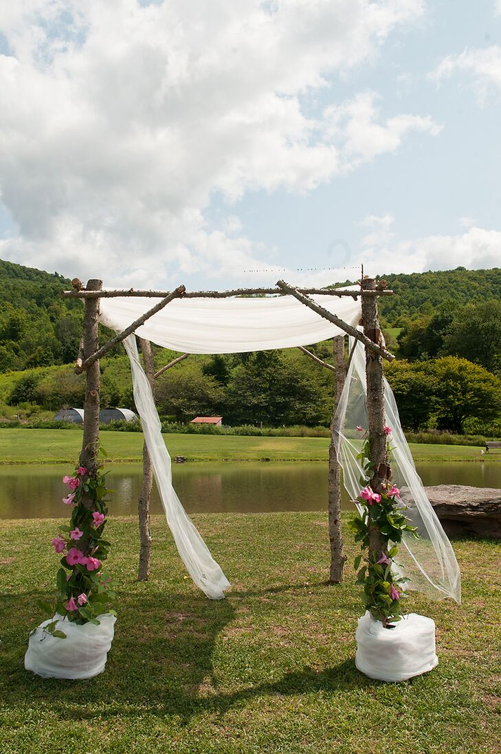 Wooden Ceremony Arch With White Drapery