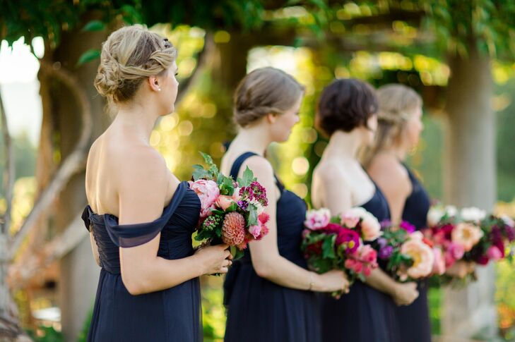 Bridesmaids in Navy Dresses Holding Bright Bouquets
