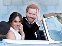 Prince Harry and Meghan Markle reception dress and aquamarine ring