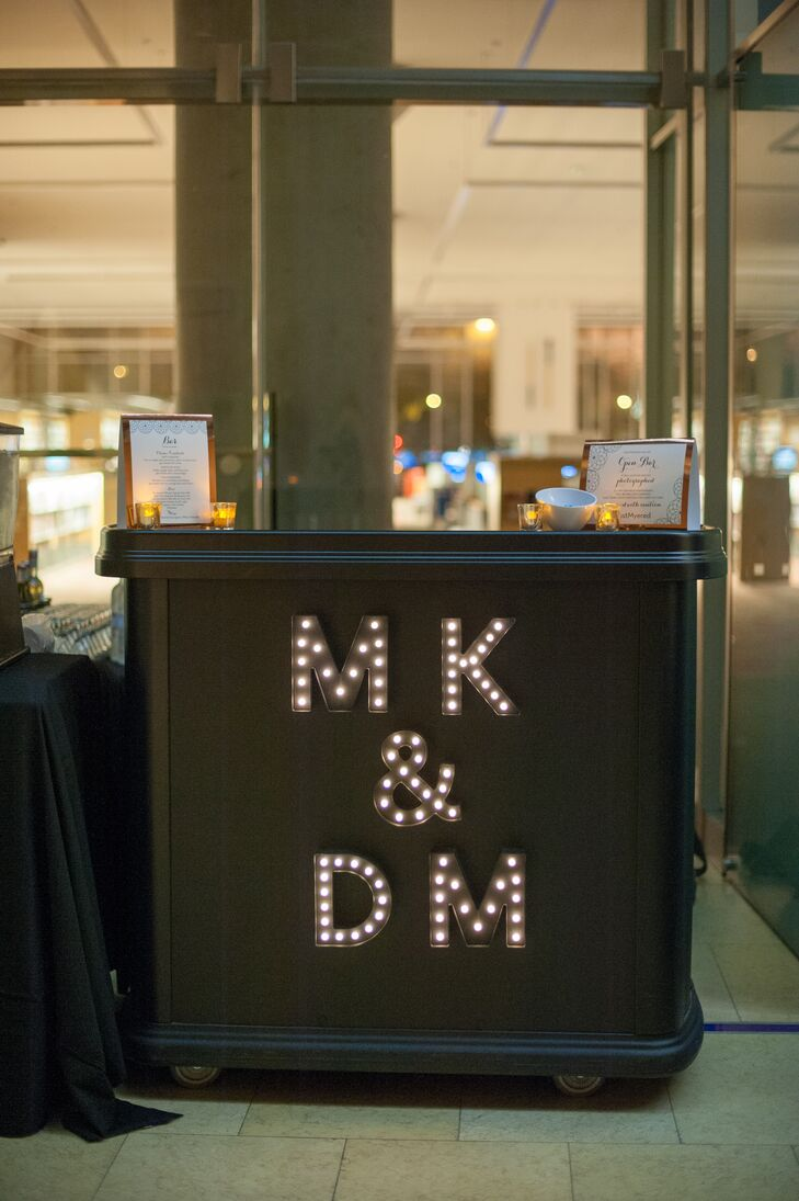 Guests sipped on craft beers and enjoyed classic cocktails from the bar, which was illuminated with the couple's initials.