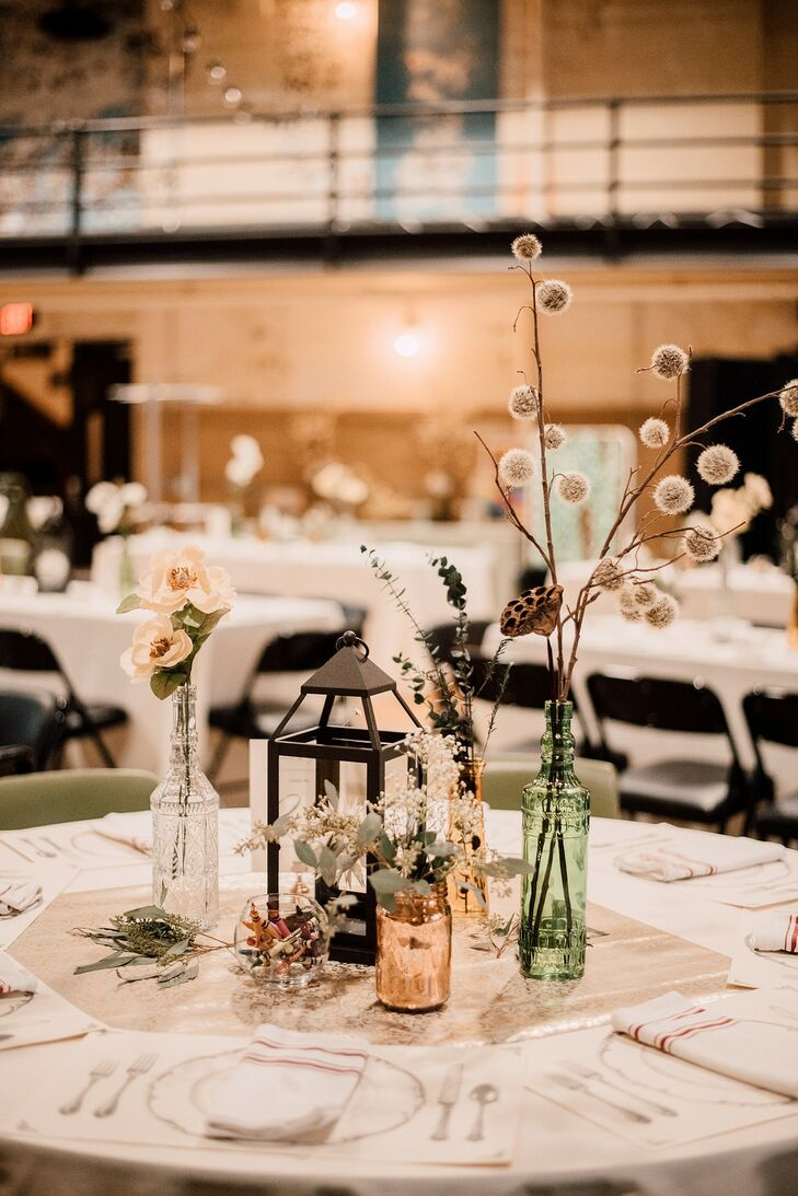 Eclectic Centerpiece with Lantern. Vintage Vases and Flowers