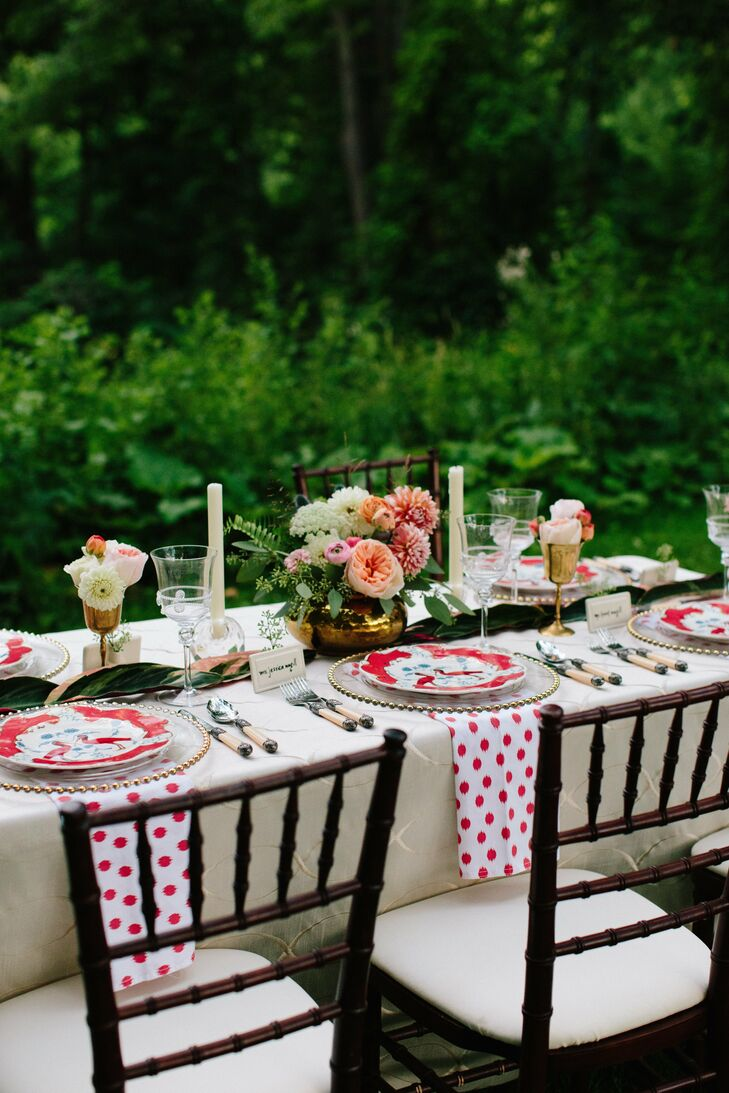The colorful place settings included white and red polka-dot napkins and flamingo plates.