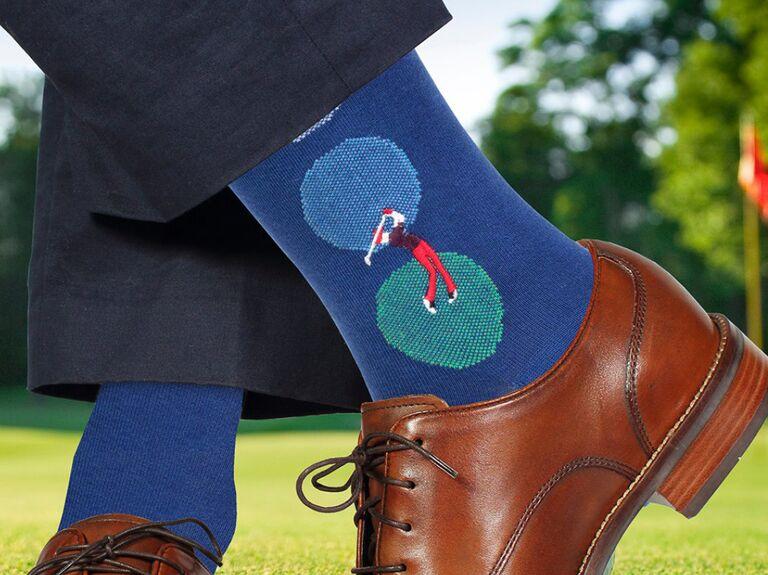 Close-up of man wearing stylish golf-themed socks