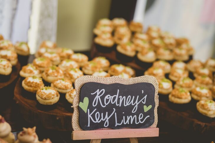 The dessert table was filled with all their favorite treats. Sweetness Bakeshop made Key lime mini cupcakes for Rodney, maple-bacon-flavored cupcakes for Roxy and vanilla bean cupcakes for his daughter. Each one was piled onto a wooden tier, fitting the rustic, vintage vibe.