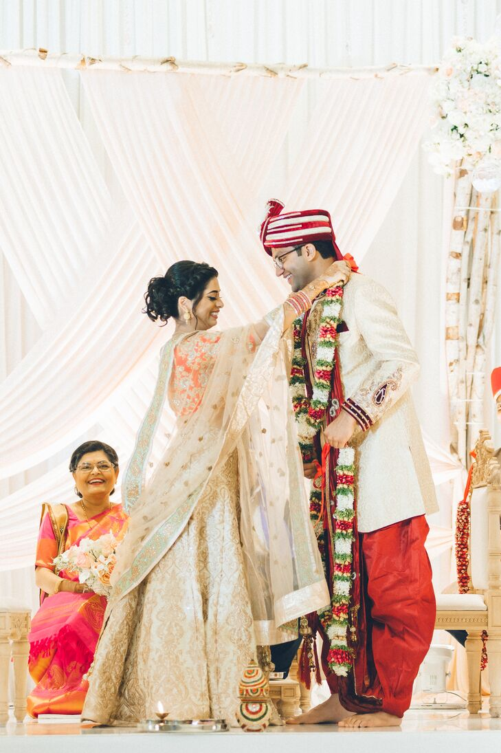 Bride Placing Marigold Necklace on Groom at Hindu Ceremony