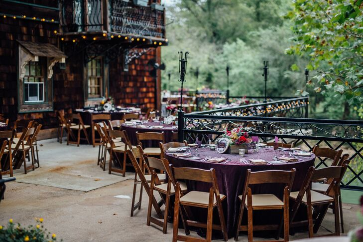 Round Tables with Purple Tablecloths and Wooden Chairs