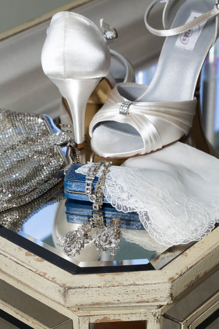 Beth wore silver heels and art deco jewelry borrow from friends. She carried her grandmother's mesh silver purse and lace handkerchief on her wedding day.