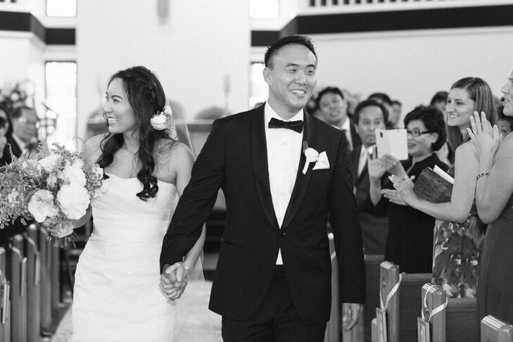 """Joyce wore an ivory Gemma by Vera Wang mermaid wedding dress with blush sequin and rosette detailing. """"My jewelry consisted of a cross bracelet given to me by my father, and two bracelets from Van Cleef & Arpels, a wedding gift from Jae,"""" says Joyce. Jae wore a classic black Hugo Boss tuxedo with Prada dress shoes."""
