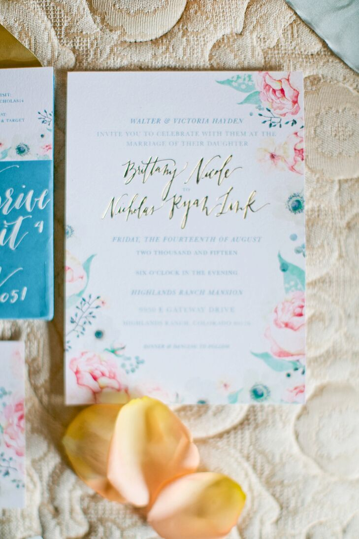 """We called our theme 'a romantic garden' and centered everything on this,"" Brittany says. Invitations set the tone for the August wedding with a palette of cream, dusty blue and light peach-pink, mixed with hints of gold and glitter."