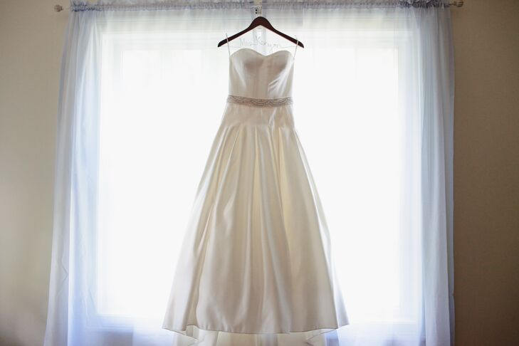 Jacquelyne wanted a timeless wedding dress style and chose a strapless A-line dress with a beaded sash.