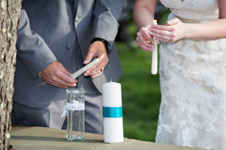 During their outdoor ceremony on the lawn of Stonewall Farm, Rachel and Mark performed a traditional unity candle lighting to symbolize the coming together of their two lives. The pair wrapped the simple white pillar candle in vibrant teal ribbon to tie in with the rest of the day's cheerful color palette.