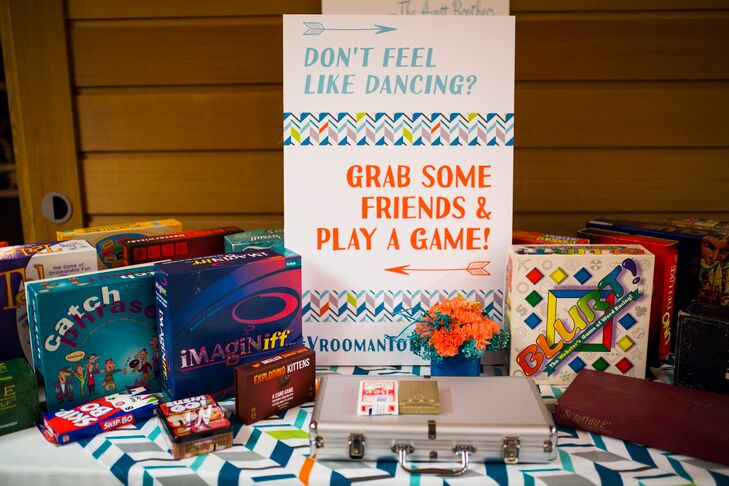 A table filled with board games served as an alternative option for guests not up for dancing.