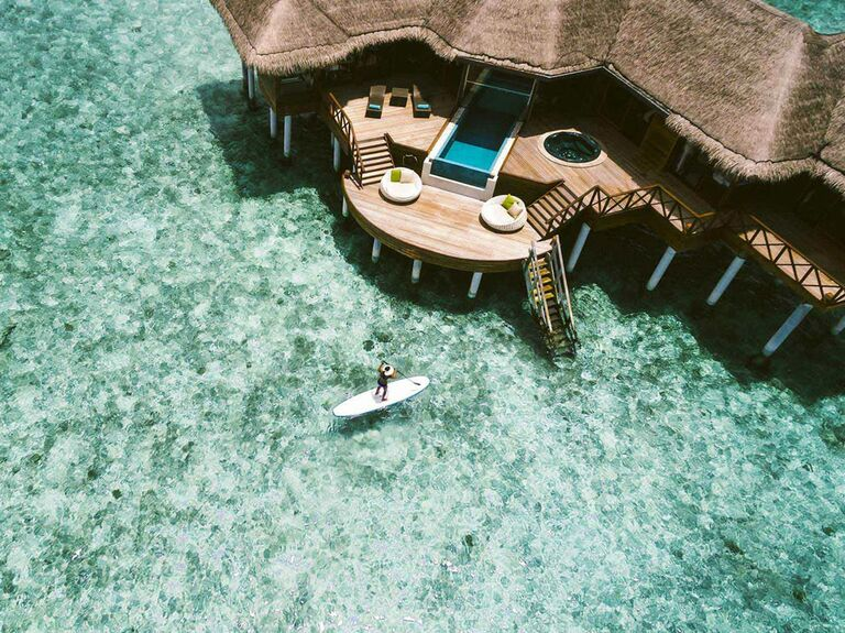 Maldives Per Aquum beach resort honeymoon with private over the water bungalow