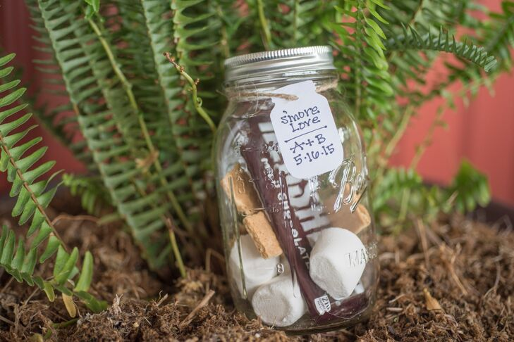 Andrea and Byron gave their guests mason jars filled with s'mores supplies for a sweet touch at the end of their wedding.