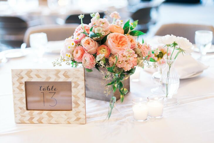 Romantic, pink centerpieces made from ranunculus and garden roses adorned each table.