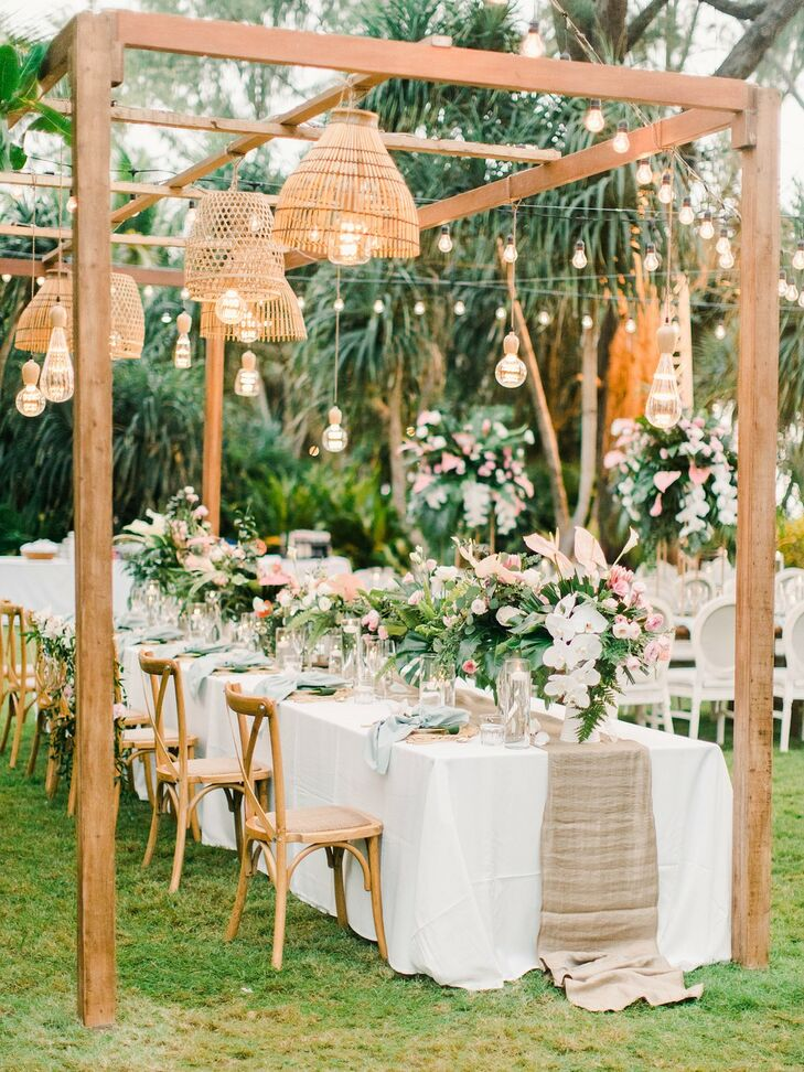 Outdoor Luxury Reception with Hanging Lights, Tropical Centerpieces and White Linens