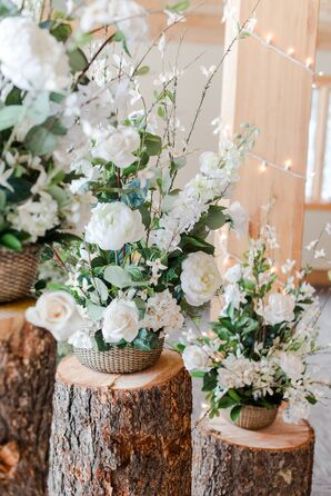 White Rose Floral Arrangements on Tree Trunk Pedestals