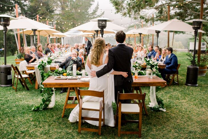 Intimate Outdoor Reception with Umbrellas and String Lights