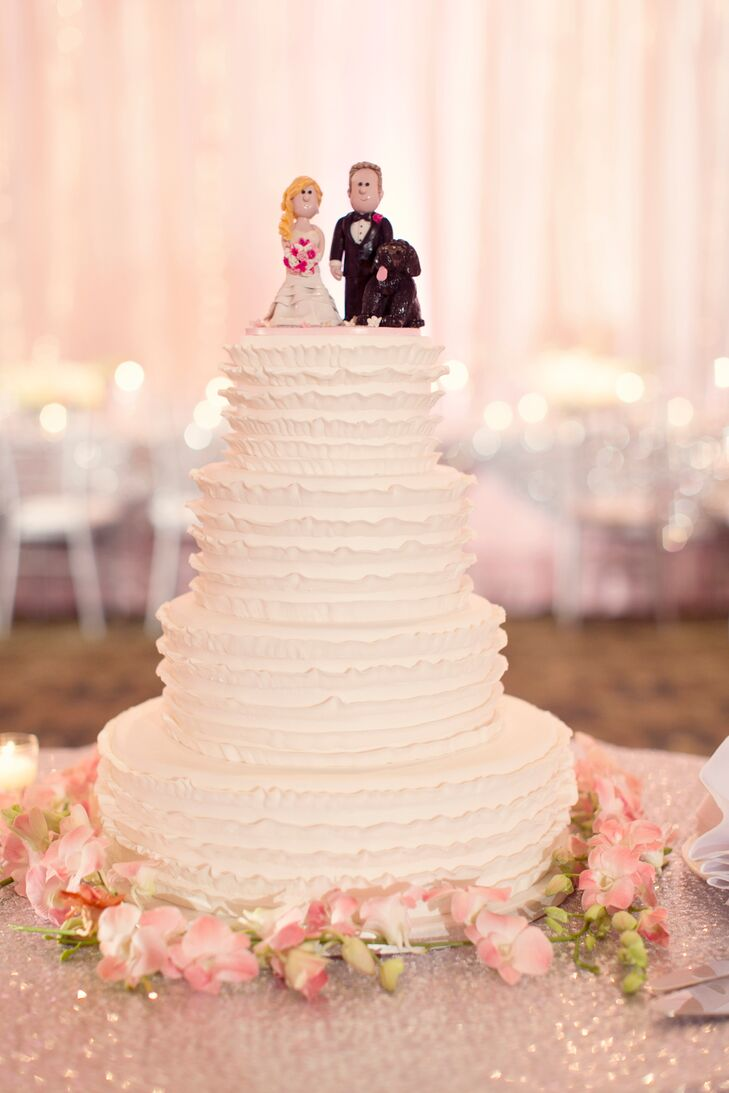 White Ruffled Wedding Cake with Clay Cake Topper