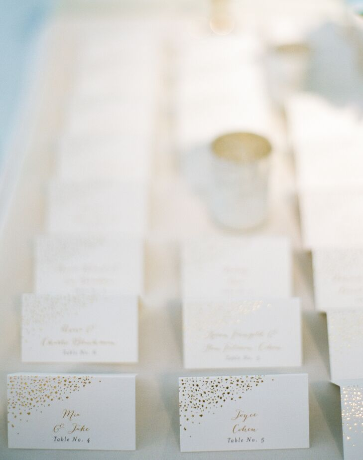 Mia and Jake wove the gold-splatter motif from their invitations into the day-of stationery elements, including the escort cards. Guests' names were written in gold-foil script and accompanied by playful gold confetti for a festive feel.
