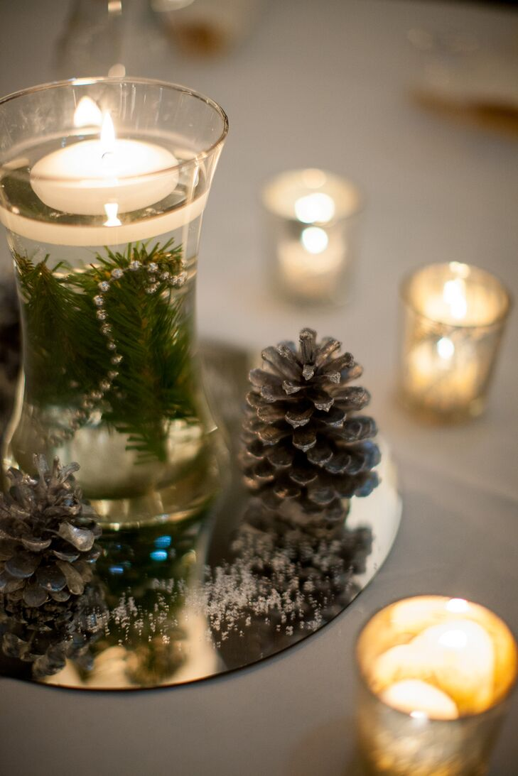 All of the wedding décor was DIY and very minimalist, including floating tea candle centerpieces with pine needles and pinecones (all in the holiday spirit!).