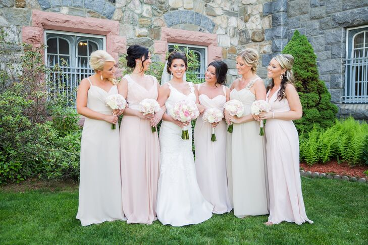 Wanting her bridesmaids to wear something they loved and felt comfortable in, Justina let them choose their own gowns. Her only requests were that the dresses be floor length and fit into the champagne and blush color scheme. They settled on a variety of A-line and empire-waist styles from Alfred Angelo, Bill Levkoff and Sorella Vita.