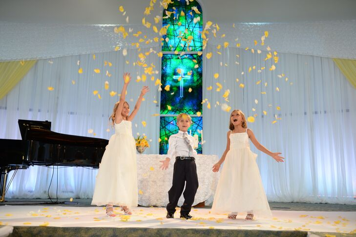 The flower girls and ring bearer threw yellow petals up in the air during the reception in keeping with the festive spirit of the day.