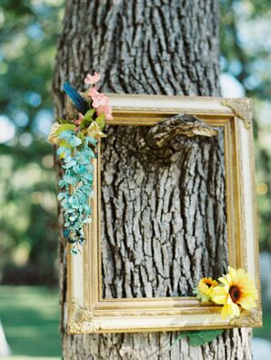 Gold Frame with Flowers Hanging on Tree