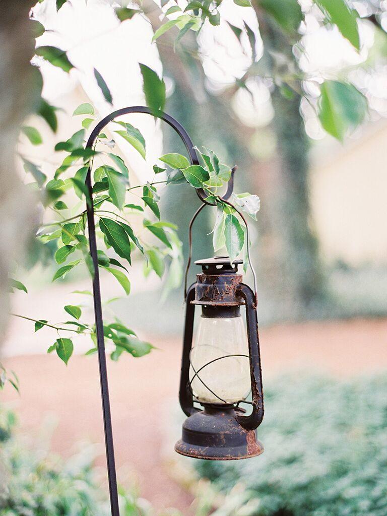 Rustic wedding ceremony aisle decor with vintage lanterns