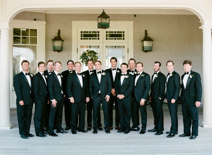 Gil's 14 groomsmen sported classic black tuxedos, and as a gift, the groom gave them matching Kiawah Island cuff links embellished with an oak tree to wear for the nuptials.