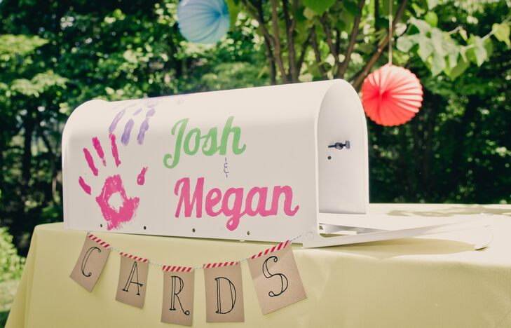 Instead of a traditional guest book, the bride and groom painted a white mailbox with their handprints and names for guests to place handwritten wedding cards inside of.