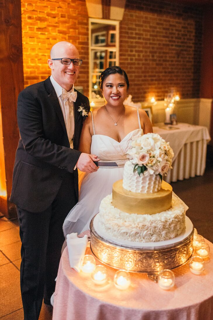 Michelle and Thorsten chose a gold and white three-tier cake by Magnolia Bakery. Each tier had was different: a lemon cake with strawberry jam, a hummingbird cake and a red velvet cake with vanilla buttercream.