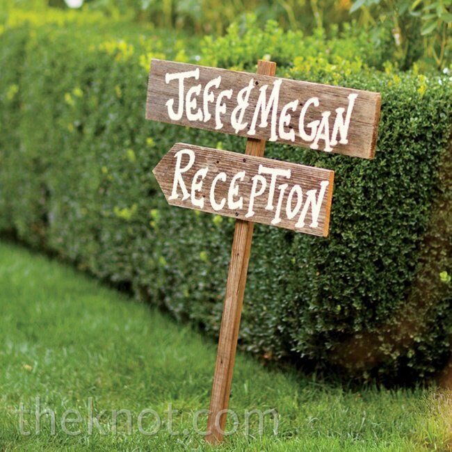 Wooden signs added a touch of rustic charm to the lush space.