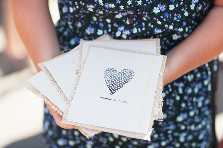 The chevron heart motif adorning the front of Danielle and David's ceremony programs had a fingerprint-inspired look, a fitting choice for the couple's ultra-personalized celebration.