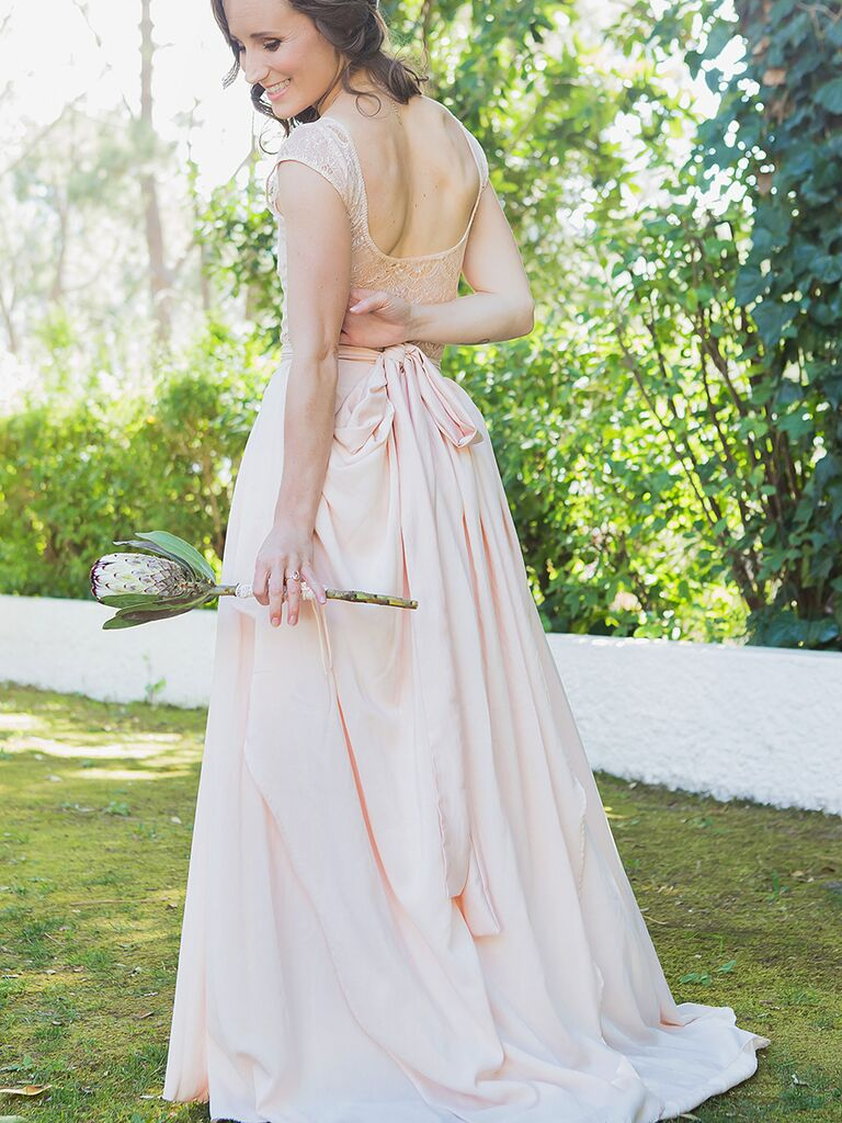 Custom made blush pink wedding gown with lace bodice