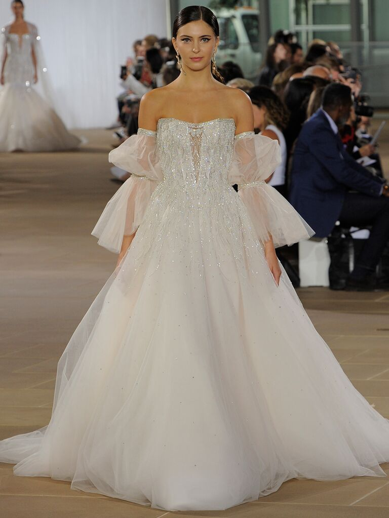 Ines Di Santo Fall 2019 ball gown wedding dress with an embellished bodice and off-the-shoulder dramatic sheer sleeves