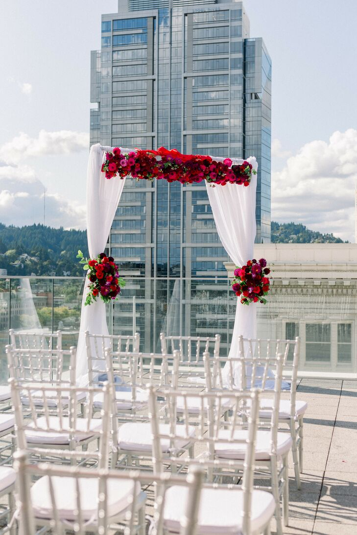 Modern Rooftop Mandap with White Draping and Red Flowers