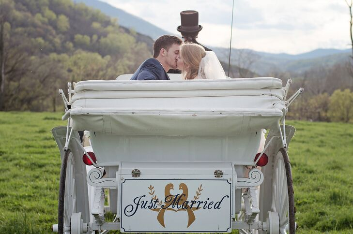 """Instead of a getaway car, the couple decided on a horse-drawn carriage to make their exit from the reception. Four white horses pulled the decorated white buggy, which had the words """"Just Married"""" painted on the back."""