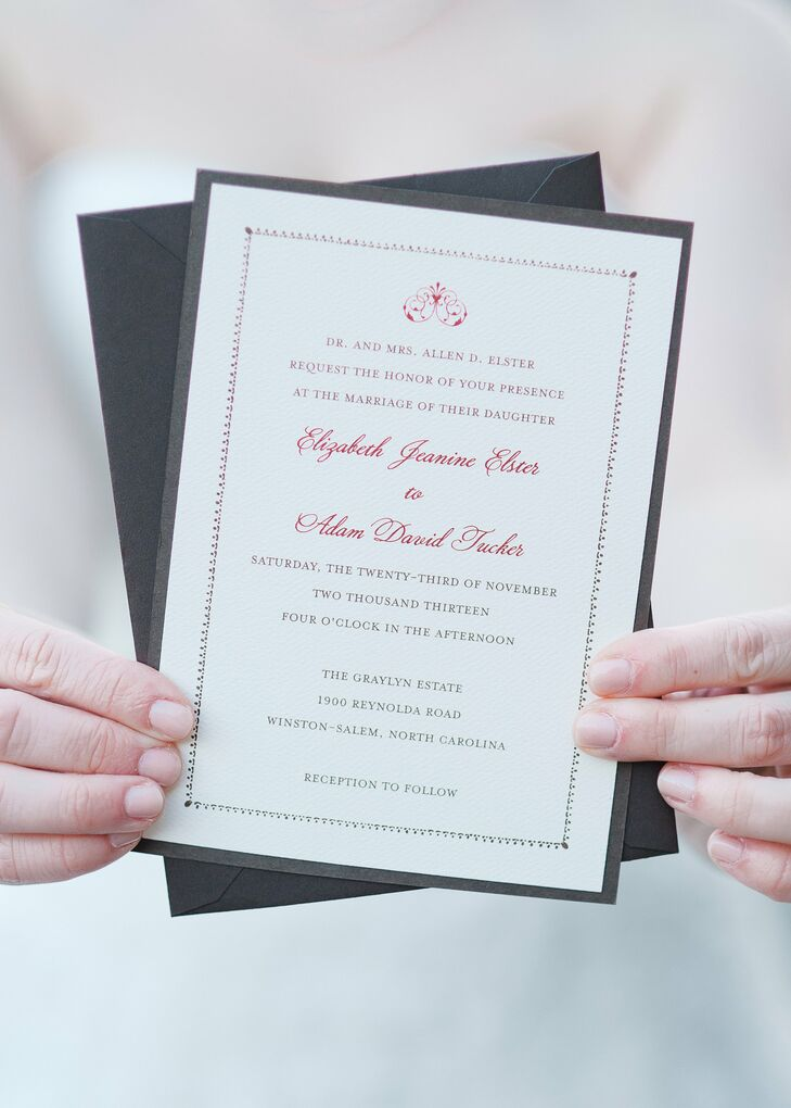 Traditional invitations with a dark red script and an elegant border set the tone for the wedding's elegant, formal theme.