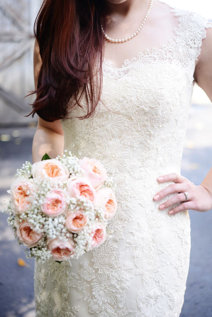 Jessica's bouquet was full of light pink roses and baby's breath for a classic bridal feel.