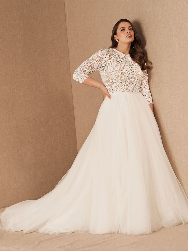 Mixed material dress with lace bodice and three-quarter sleeves with a full tulle skirt