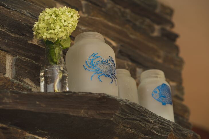 Frosted mason jars were silk screened with nautical animals, perfectly fitting the seaside ceremony and reception location.