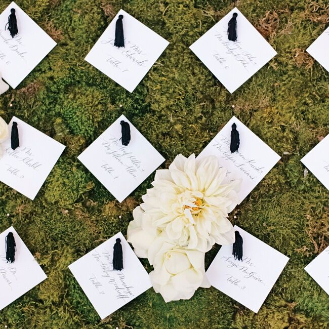 Black tassels were attached to the crisp white escort cards, tying in with the rest of the wedding decor.